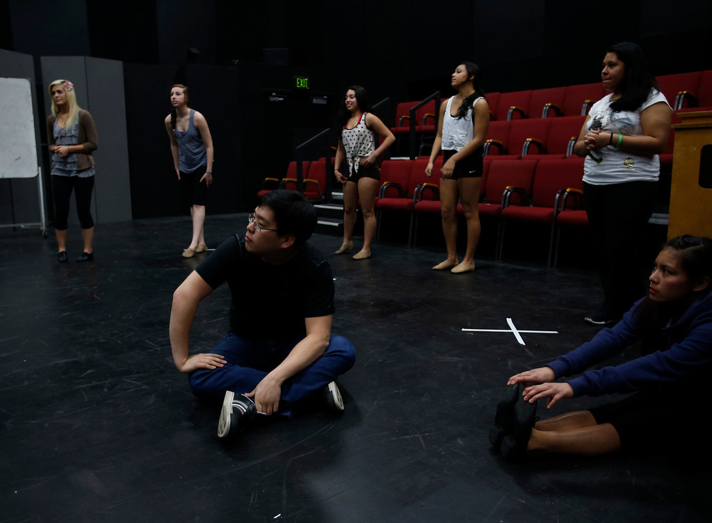 . People listen to instructions during auditions during a casting call for Great America theme park for their various characters and dancers in Hall Todd Theatre at San Jose State University on Wednesday, Feb. 6, 2013.  (Nhat V. Meyer/Staff)