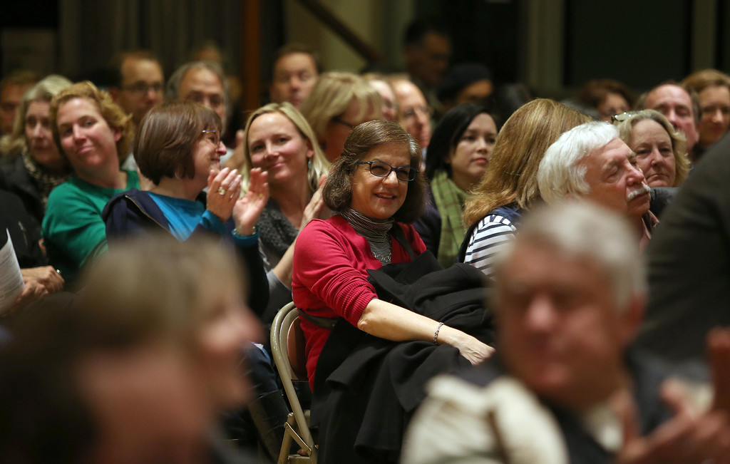 . Rose Marie Sarfaty, of Piedmont, center, listens to Piedmont Police Chief Rikki Goede speak during a town hall meeting at the Piedmont Veterans Hall in Piedmont, Calif., on Tuesday, Feb. 12, 2013. (Jane Tyska/Staff)