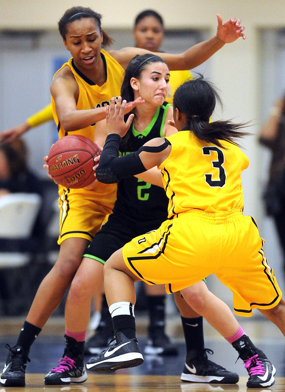 . Bishop O\'Dowd High\'s Oderah Chidom (22) right, gets past Miramonte High\'s Nadine Masarweh (2) in the first period of their Division III North Coast Section basketball game in Dublin, Calif., on Saturday, March 2, 2013. Bishop O\'Dowd High went on to win the game 77-48. (Doug Duran/Staff)