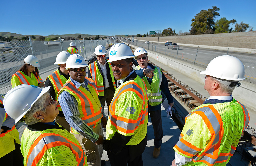 . Antioch city mayor Wade Harper, center, glances back while visiting the construction site of a BART platform at Bailey Road on Highway 4 in Pittsburg, Calif., on Monday, Feb. 11, 2013. Members of the media with state and local city officials traveled on a bus tour of the Highway 4 expansion project in East County. The tour took visitors to construction sites on Railroad Ave and the new eBART station being built on Bailey Road. (Jose Carlos Fajardo/Staff)