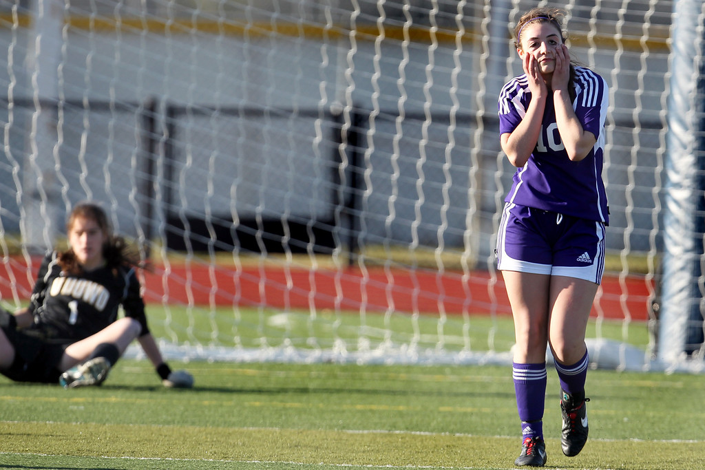 . Piedmont\'s Natalie Greening (10) reacts after missing her penalty kick against Bishop O\'Dowd goalie Lorna McElrath (1) in the North Coast Section Division II Girls Soccer Championship at Dublin High School soccer field in Dublin, Calif., on Saturday, Feb. 23, 2013. Bishop O\'Dowd won 3-2 in a series of penalty kicks. (Ray Chavez/Staff)