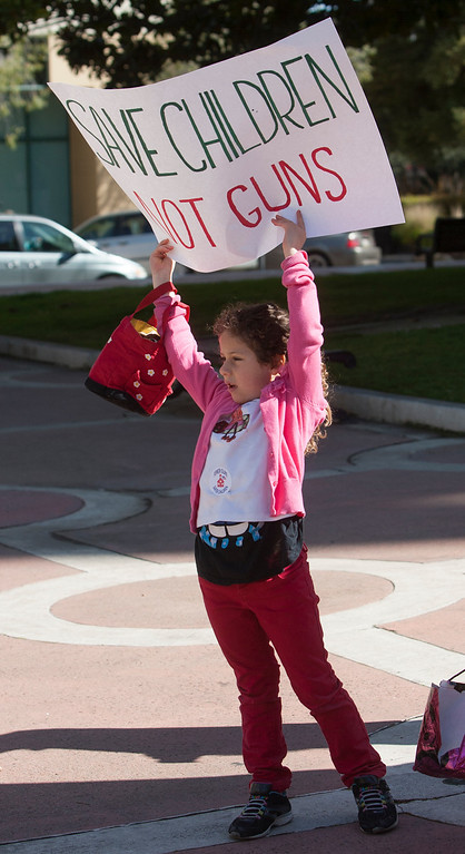 . Tarahneh Widemann, 6, holds sign at the Silicon Valley Community Against Gun Violence  rally in front of Palo Alto City Hall . (John Green/Staff)