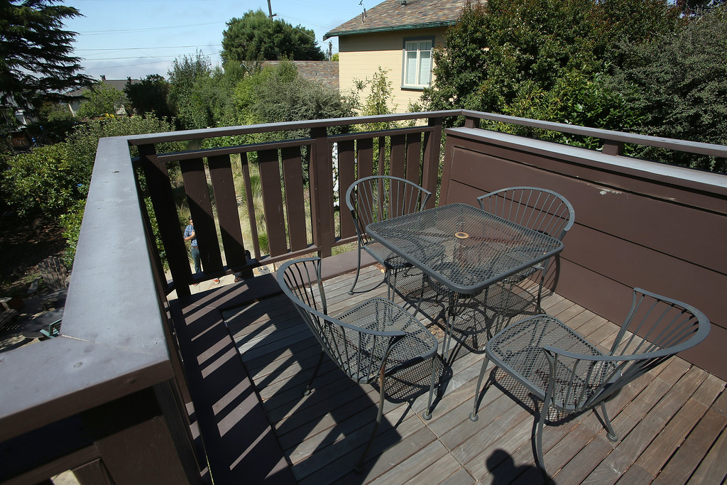 . A deck off the master bedroom of a remodeled 1937 one-bedroom cabin is seen on Woodmont Avenue in Berkeley, Calif., on Thursday, July 25, 2013.  Architect Gustave Carlson, of Gustave Carlson Design in Berkeley, managed the project. (Jane Tyska/Bay Area News Group)