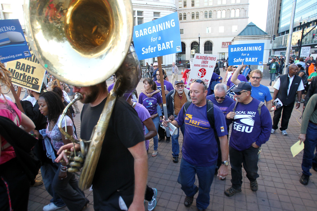 . Unions members and supporters of BART workers head back to Frank Ogawa Plaza after marching to the BART headquarters in Oakland, Calif., on Thursday, Aug. 1, 2013. (Ray Chavez/Bay Area News Group)