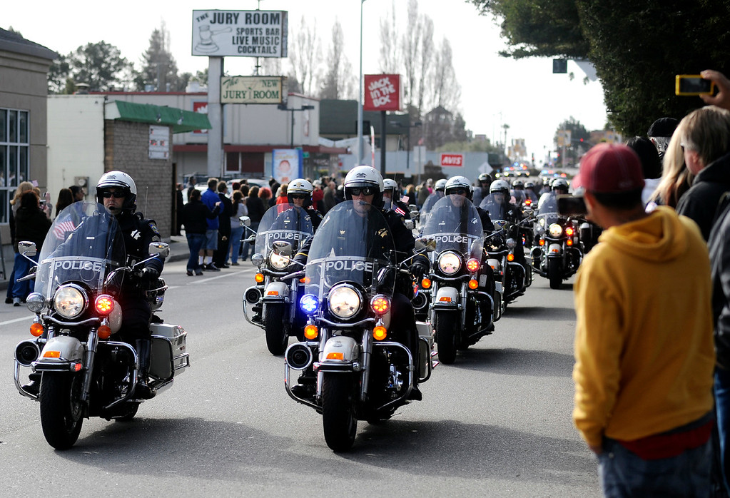 ". The funeral procession for detectives Sgt. Loran ""Butch\"" Baker and Elizabeth Butler is led down Ocean Street in Santa Cruz, Calif., on Thursday morning, March 7, 2013,  by a train of motorcycles. (Matthew Hintz/Santa Cruz Sentinel)"