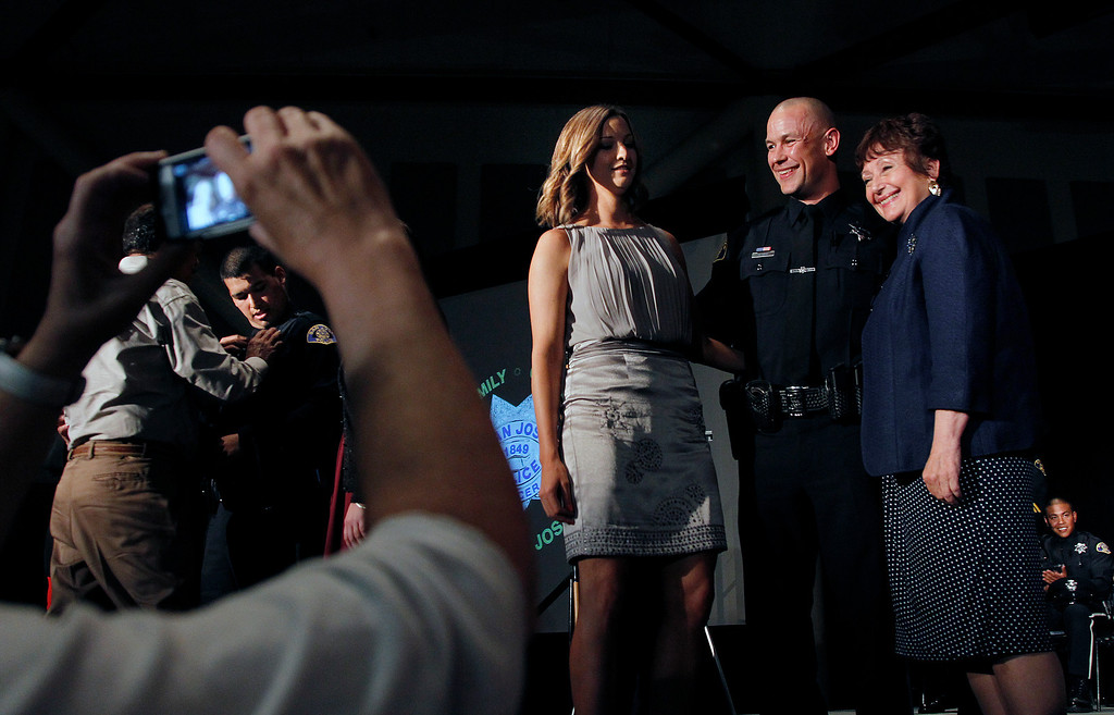 . At center, San Jose Police Department Recruit Officer Willy Leys has his photo taken with his mother Bonnie Leys, right, and his girlfriend Jeanine Thomas, left at the San Jose Police Academy graduation in San Jose, Calif. on Friday, March 15, 2013.   (LiPo Ching/Staff)