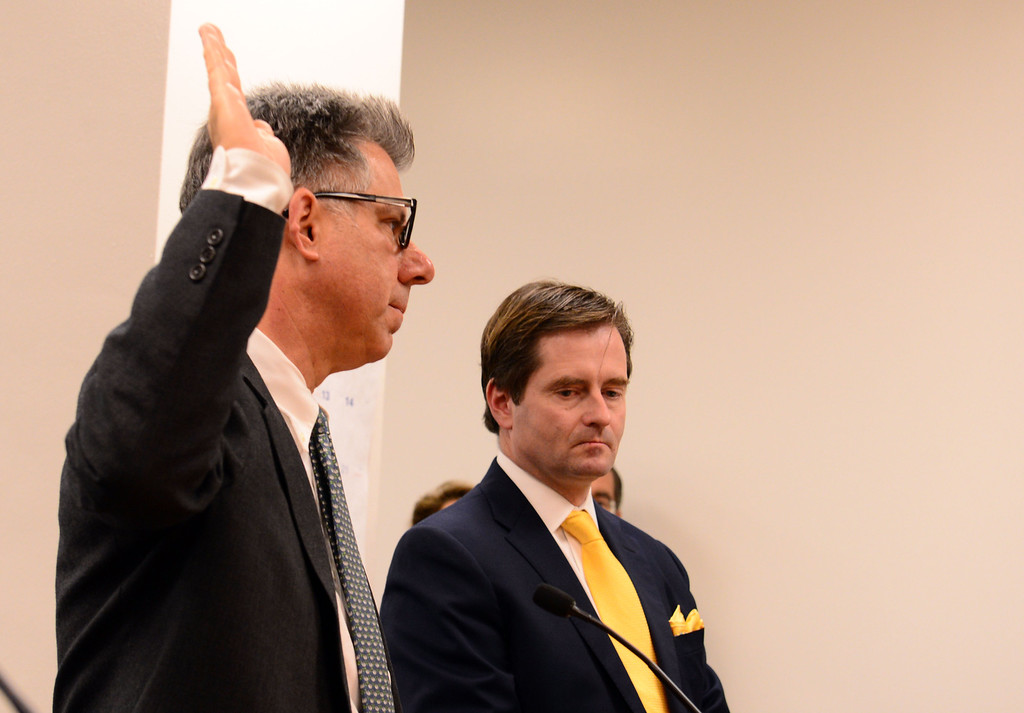 . Dr. Paul Fisher is sworn in before he testifies on the case of 13-year-old Jahi McMath, with the families attorney Christopher Dolan nearby in Alameda County Superior Court in Oakland, Calif., on Tuesday, Dec. 24, 2013. Judge Grillo on Tuesday denied a petition by the family of Jahi McMath to have Children\'s Hospital Oakland keep the brain-dead girl on a ventilator past Dec. 30. (Susan Tripp Pollard/Bay Area News Group)
