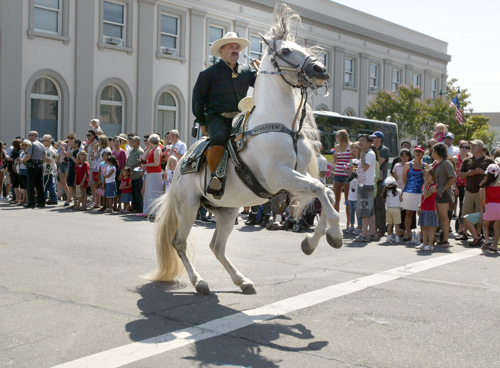 . A charro or Mexican cowboy and his horse perform tricks as they take part in the Alameda Mayor\'s July 4th Parade on Park Street in Alameda, Calif., on Thursday, July 4, 2013. (Ray Chavez/Bay Area News Group)