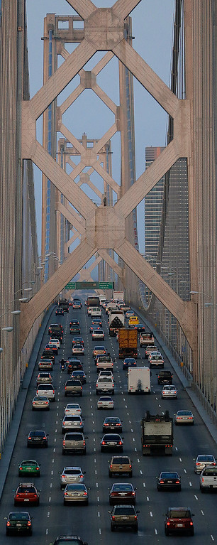 . Commuters make their way over the San Francisco-Oakland Bay Bridge, Monday, July 1, 2013, in Oakland, Calif. (AP Photo/Ben Margot)