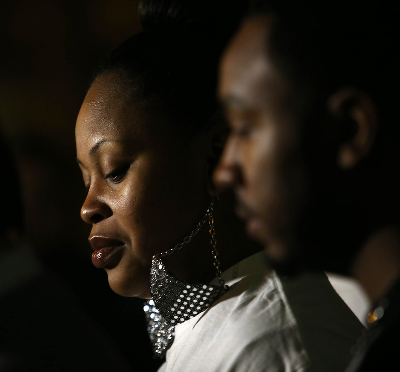 . Nailah Winkfield, left, mother of Jahi McMath, 13, listens during a press conference after a federal court settlement hearing with Children\'s Hospital Oakland attorney Douglas C. Straus at the Ronald V. Dellums Federal Building in Oakland, Calif., on Friday, Jan. 3, 2014. To the right is her brother Omari Sealey. After an agreement in Alameda County Superior Court, and more than three weeks after the girl was declared brain-dead by doctors at Children\'s Hospital Oakland, her mother will be allowed to take her daughter home from the facility as long as she assumes full responsibility for her health. (Jane Tyska/Bay Area News Group)