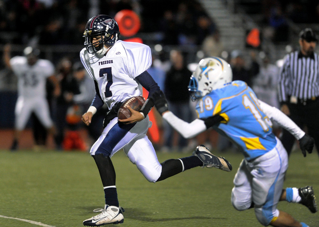 . <p>18. DANTE MAYES � QUARTERBACK � FREEDOM</p> Mayes (7) gets past Heritage High\'s Colton Selin (17) as he runs for a touchdown in the first quarter of their football game in Brentwood, Calif., on Friday, November 4, 2011. (Doug Duran/Staff)