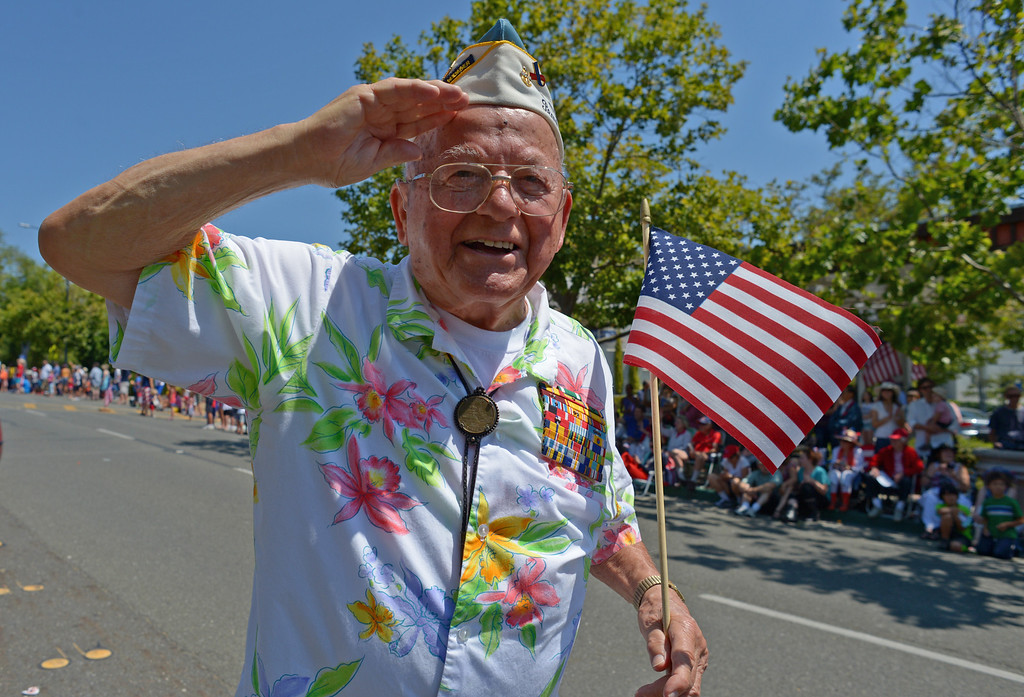 . Pearl Harbor survivor and World War II veteran Mickey Ganitch, 93, of San Leandro, salutes while marching during Piedmont\'s July 4th parade in Piedmont, Calif., on Thursday, July 4, 2013. (Jose Carlos Fajardo/Bay Area News Group)