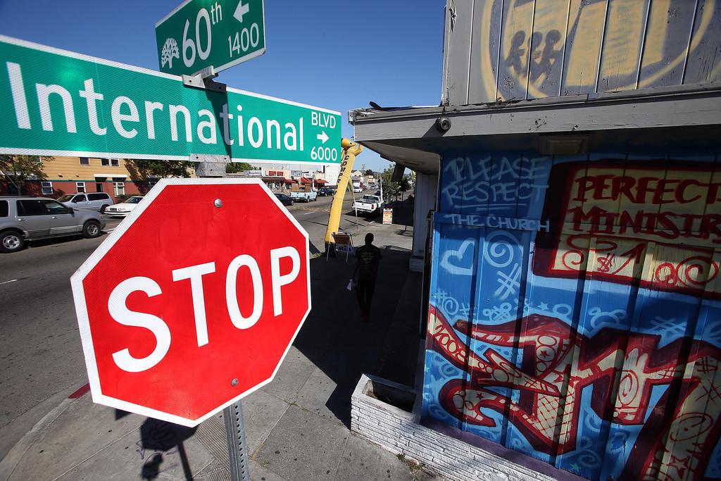 . Positive graffiti is seen at International Boulevard at 60th Avenue in Oakland, Calif., on Thursday, April 18, 2013. (Jane Tyska/Staff)