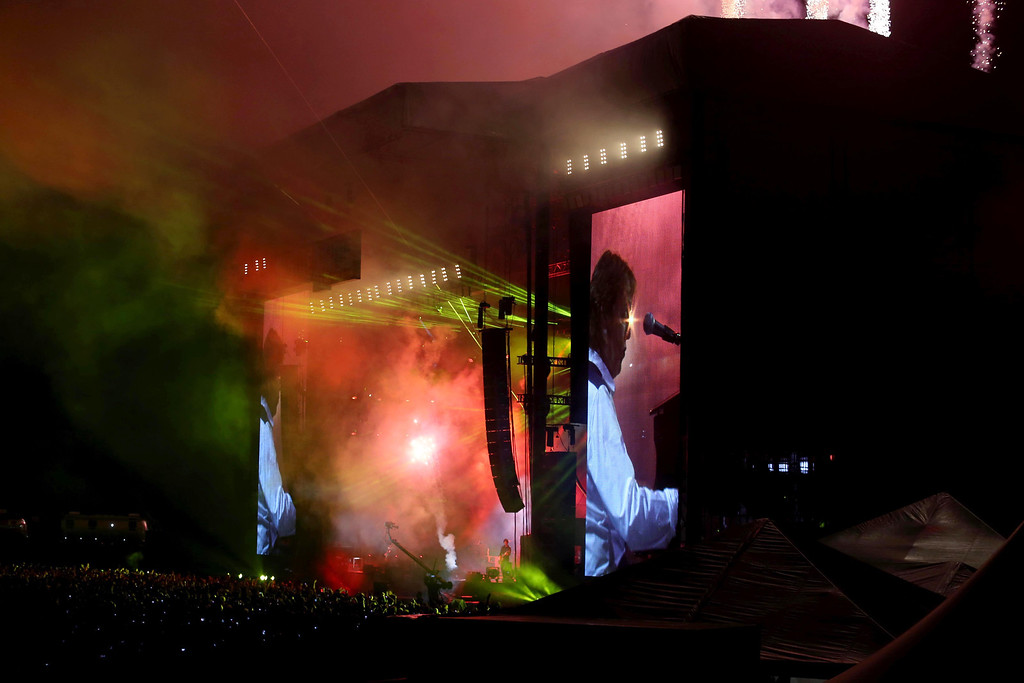 """. Paul McCartney plays \""""Live and Let Die\"""" as fireworks go off on the Land\'s End stage during the 6th annual Outside Lands Music and Arts Festival in Golden Gate Park in San Francisco, Calif., on Friday, Aug. 9, 2013.  (Jane Tyska/Bay Area News Group)"""
