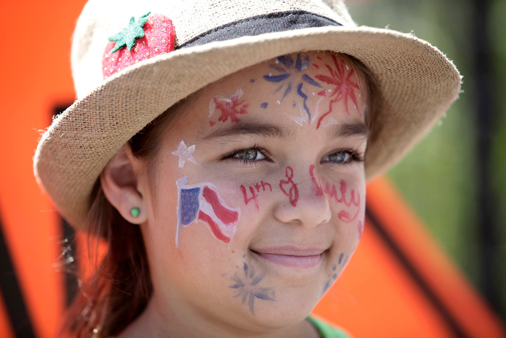 . Juliette Simpson, 10, decorated her face for the annual Fourth of July parade in Redwood City, Calif. on Thursday, July 4, 2013. Considered the largest Independence Day parade in Northern California, it is celebrating its 75th year. (Gary Reyes/Bay Area News Group)