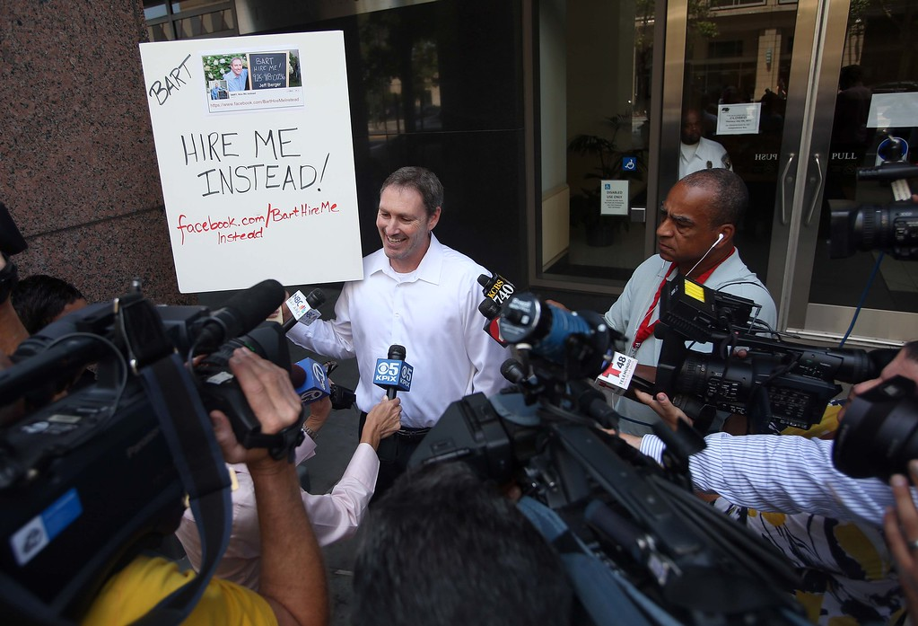 ". Jeff Berger, of Walnut Creek, speaks with the media at the Caltrans District 4 headquarters on Grand Avenue in Oakland, Calif., on Wednesday, July 3, 2013. Berger describes himself as ""underemployed\"" and wants BART to hire him. He created a Facebook page at www.facebook.com/barthiremeinstead. The BART strike is in its third day and bargaining talks resumed at 1 p.m. Wednesday. (Jane Tyska/Bay Area News Group)"