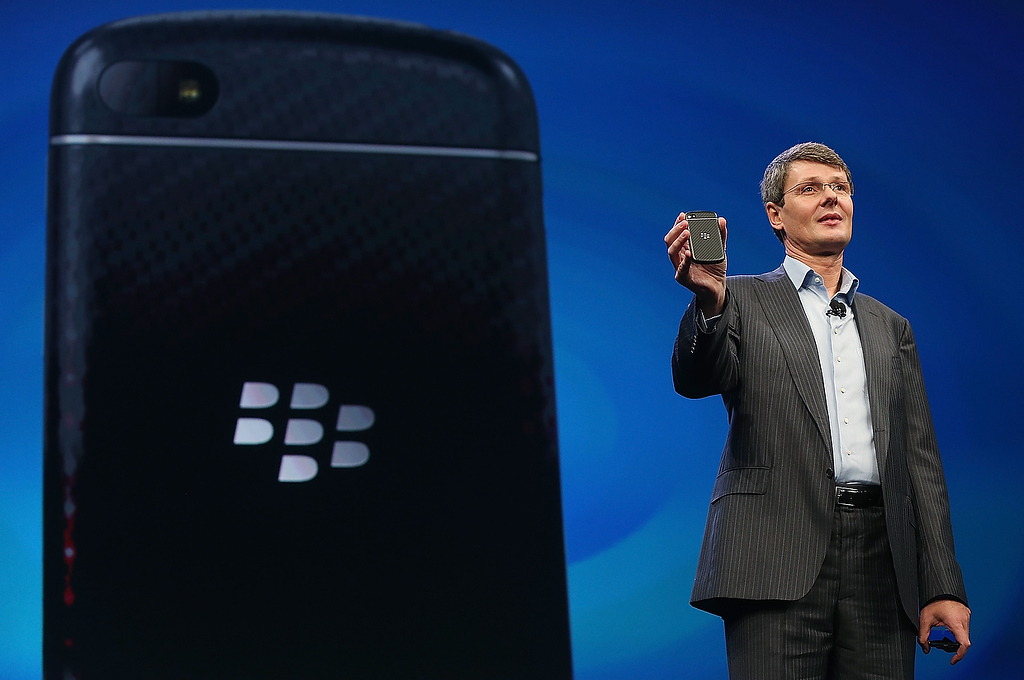 . BlackBerry Chief Executive Officer Thorsten Heins displays one of the new Blackberry smartphones at the BlackBerry 10 launch event by Research in Motion at Pier 36 in Manhattan on January 30, 2013 in New York City. The new smartphone and mobile operating system is being launched simultaneously in six cities.  (Photo by Mario Tama/Getty Images)