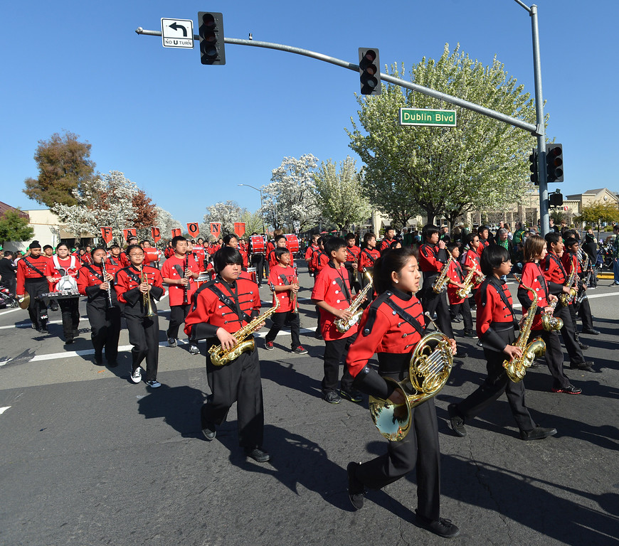 . The Fallon Middle School Mustang Band of Dublin marches down Dublin Boulevard during the Saint Patrick\'s Day Parade in Dublin, Calif., on Saturday, March 16, 2013. (Dan Rosenstrauch/Staff)