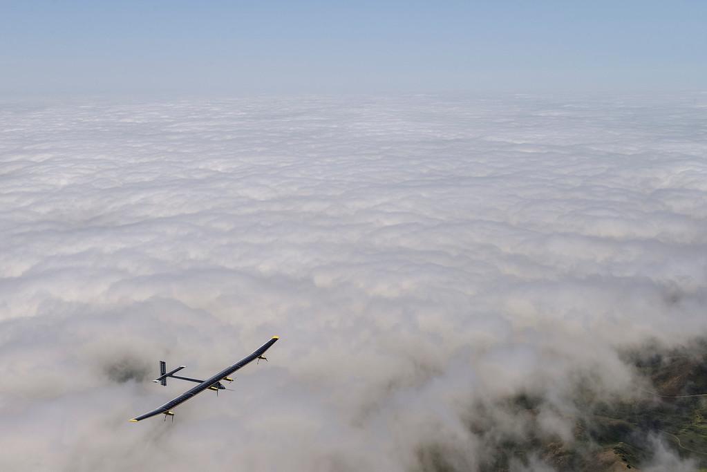 . The Solar Impulse soars above the San Francisco Bay Area fog on Tuesday, April 23, 2013, during a test flight. (Jean Revillard/Rezo/Solar Impulse/Polaris)