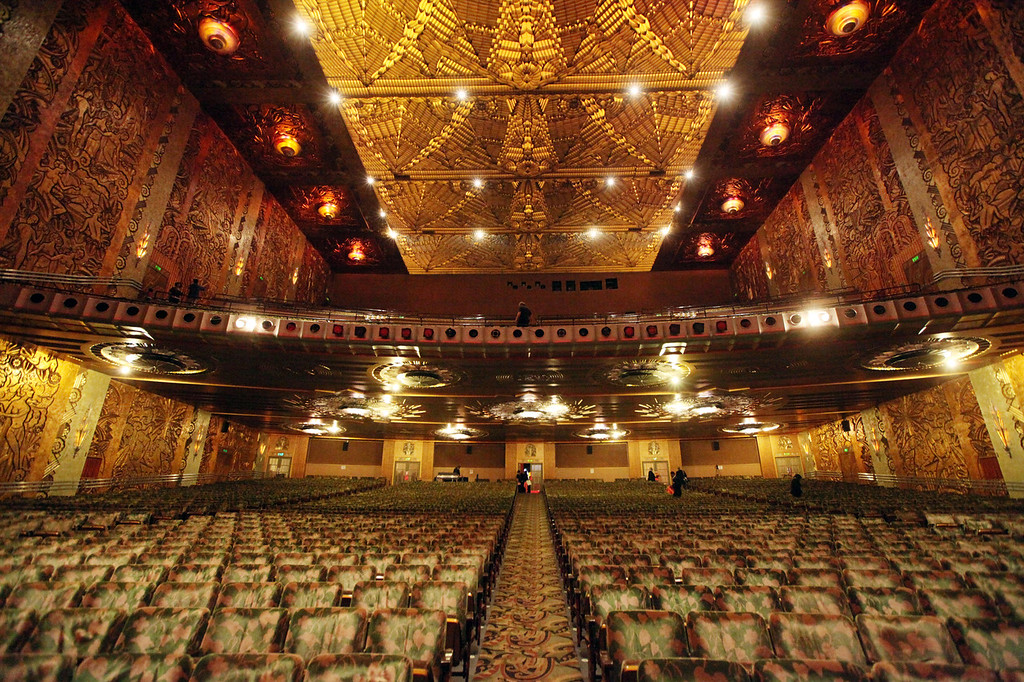 . More than 3,000 seats fill the interior Paramount Theatre in Oakland. The interior also features walls covered from floor to ceiling with murals in a golden relief. The ceiling features intricate light fixtures in floral shapes. (Laura A. Oda/Bay Area News Group)