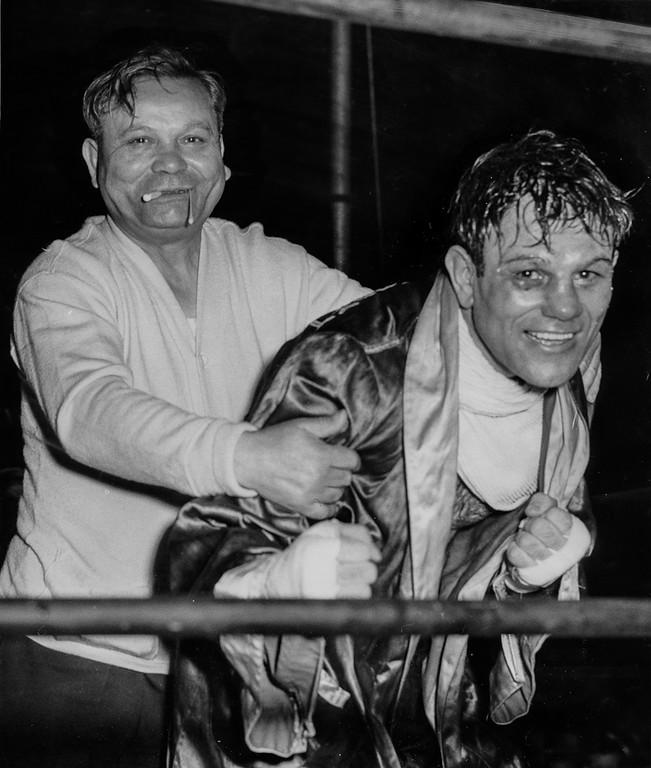 . Emeryville, CA May 10, 1950 - Former lightweight champion Sammy Angott and his trainer Charlie Warren at the Oaks Ball Park. (Jim Edelen / Oakland Tribune)