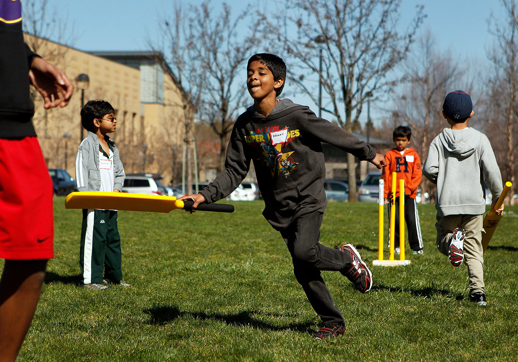 . Keshav Kannan, 7, runs after batting at the cricket festival sponsored by the California Cricket Academy at the Cupertino Library Field\'s cricket pitch in Cupertino, Calif. on Saturday, March 9, 2013.  Boys and girls ages 5-13 were invited to attend and learn the basics of the game.  (LiPo Ching/Staff)