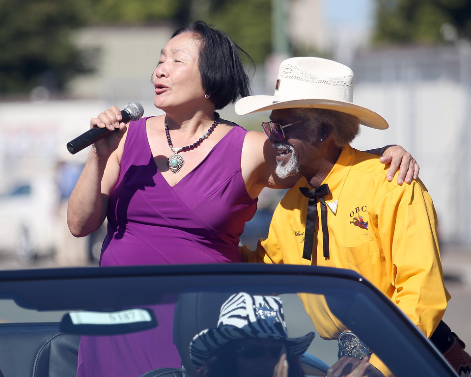 . Oakland Mayor Jean Quan, left, thanks Oakland Black Cowboy Association president Wilbert McAlister during the 39th annual Oakland Black Cowboy Parade and Heritage Festival in Oakland, Calif., on Saturday, Oct. 5, 2013. The event also featured food, entertainment and pony rides for kids at De Fremery Park. The OBCA began in 1975 and educates the public about the role that black cowboys played in history and building of the west. (Jane Tyska//Bay Area News Group)