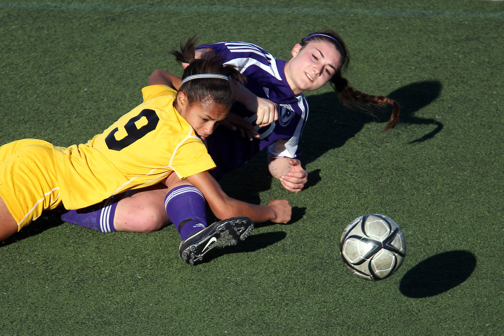 . Bishop O\'Dowd\'s Taylor Hobbs (9) fouls Piedmont\'s Natalie Greening (10) in the second half of over time of their North Coast Section Division II Girls Soccer Championship at Dublin High School soccer field in Dublin, Calif., on Saturday, Feb. 23, 2013. Bishop O\'Dowd won 3-2 in a series of penalty kicks. (Ray Chavez/Staff)