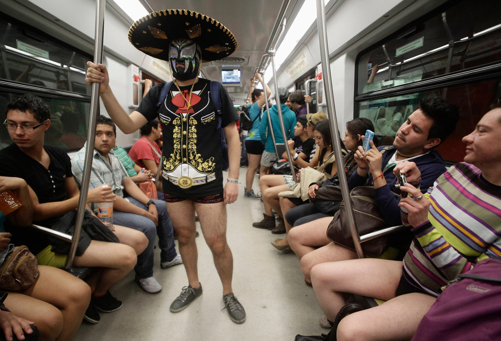 ". A participant of ""No Pants Subway Ride\""stands in a subway train in Mexico City January 13, 2013. The event is organized by Flashmob Mexico where participants have to strip down to their underwear as they go about their normal routine, said organisers. (REUTERS/Henry Romero/MEXICO)"