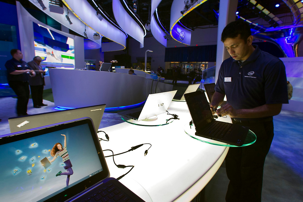 . Raman Chari prepares a display of convertible Ultrabooks at the Intel booth prior to the opening of the Consumer Electronics Show (CES) in Las Vegas January 8, 2013. (REUTERS/Steve Marcus)