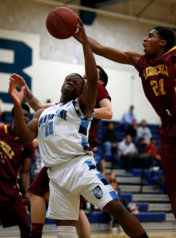 . Bellarmine College Preparatory\'s Kenneth Olugbode (20) fights for a rebound against Lincoln High School\'s Tarrez Blaylock (24) during their NorCal Division I Round 1 game in the third period at Bellarmine College Preparatory in San Jose, Calif., on Wednesday, March 6, 2013.  (Nhat V. Meyer/Staff)