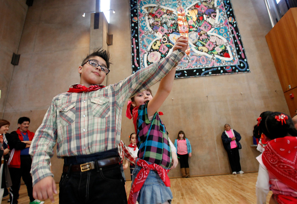 . From left, Brian Valtierra, 10, and Karla Porres, 8 of the Folklorico Sante Dance Group perform at the grand opening celebration of the Seven Trees Branch Library, in San Jose, Calif. on Saturday, January 26, 2013.   (LiPo Ching/Staff)