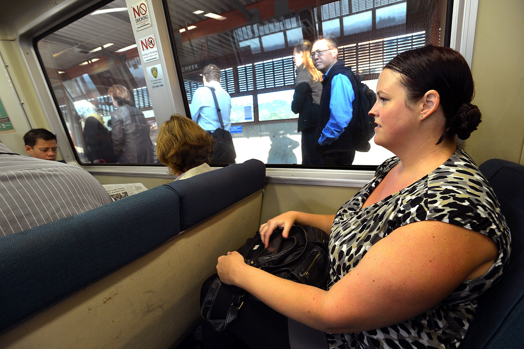. Lori Myers, of Walnut Creek, sits in a BART station on her way to her job in San Francisco, where she will get off at the Embarcadero station, in Pleasant Hill, Calif., on Tuesday, July 20, 2013. Myers, a legal secretary by day and dance instructor by night, is one of many Bay Area commuters without the option to telecommute or take advantage of many ride-sharing options if BART goes out on strike. (Dan Rosenstrauch/Bay Area News Group)