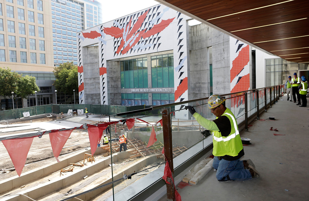 . Frank Hernandez installs safety rails on the balcony of the Grand Ballroom of the newly expanded and renovated San Jose McEnery Convention Center in San Jose, Calif. on Tuesday, Aug. 6, 2013.  (Gary Reyes/Bay Area News Group)