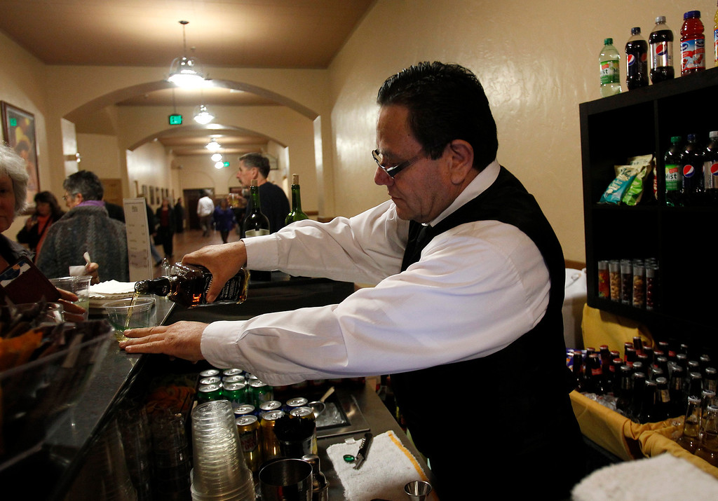 . Bartender Victor Romo serves a drink inside of the San Jose Civic before Jackson Browne performed in downtown San Jose, Calif. on Tuesday, Jan. 22, 2013.  (Nhat V. Meyer/Staff)