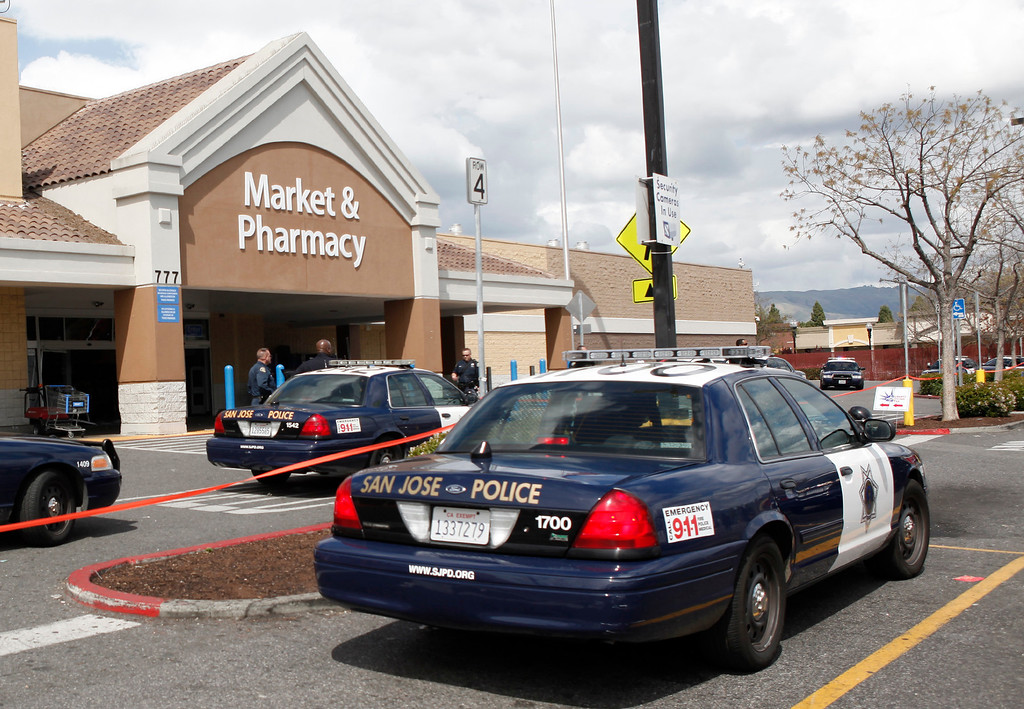 . San Jose police investigate a scene at the Walmart store on Story Road in San Jose, Calif., where a vehicle was driven into the front door on Sunday, March 31, 2013. Four people were injured in the incident. (Karl Mondon/Staff)