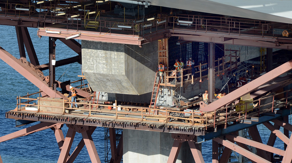 . Work continues on a permanent fix for the broken bolts on a pier of the new Bay Bridge, Friday, Nov. 1, 2013. The $23 million project is now running a month behind schedule. (Karl Mondon/Bay Area News Group)
