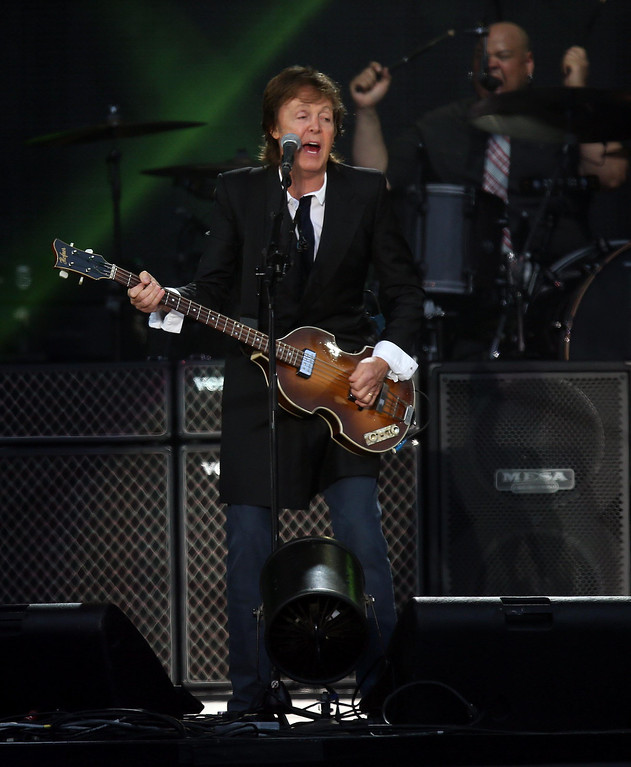 . Paul McCartney headlines on the Land\'s End stage during the 6th annual Outside Lands Music and Arts Festival in Golden Gate Park in San Francisco, Calif., on Friday, Aug. 9, 2013. To the right is drummer Abe Laboriel, Jr.  (Jane Tyska/Bay Area News Group)