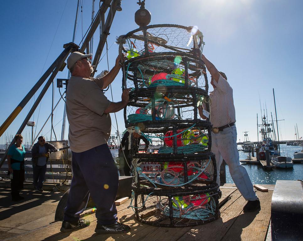 ". Fishermen Bill Webb, left and Dutch Freeman, right , load crab pots onto the \""Cricket\"". (John Green/Bay Area News Group)"