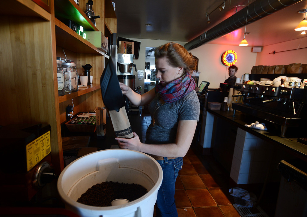 . Catahoula Coffee Company employee Amelia Hebeler bags up coffee beans for sale at the shop in Richmond, Calif. on Thursday, Jan. 17, 2013. (Kristopher Skinner/Staff)