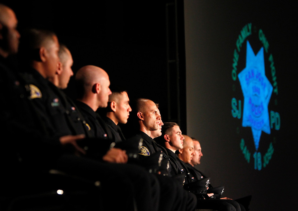 . San Jose Police Department Recruit Officers sit on stage during the San Jose Police Academy graduation in San Jose, Calif. on Friday, March 15, 2013.   (LiPo Ching/Staff)