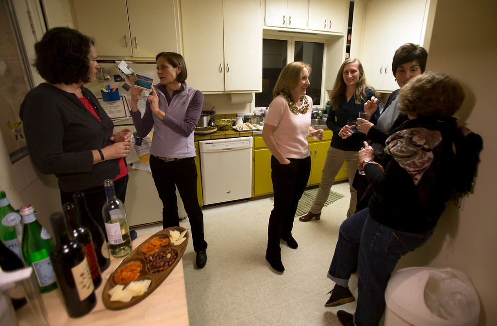 . Partiicpants chat in the kitchen during a Dining for Women fund-raising dinner, Sunday, Feb. 10, 2013 in Piedmont, Calif. The parent organization, based in South Carolina, has 350 chapters across the U.S. Every month, local chapters stage these pot luck suppers, inviting participants select a program to support in countries of extreme challenge for women. (D. Ross Cameron/Staff)