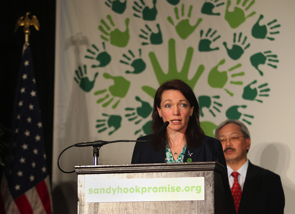 . Mother of Dylan Hockley, 6, one of the victims in the Sandy Hook school shooting, Nicole Hockley  speaks as San Francisco Mayor Ed Lee looks on at a news conference to launch the Sandy Hook Promise Innovation Initiative held in honor of the three month anniversary of the tragic shooting at Sandy Hook Elementary School at the Bill Graham Civic Auditorium in San Francisco, Calif., on Thursday, March 14, 2013. (Anda Chu/Staff)