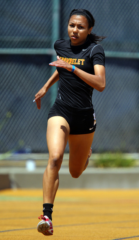 . Carondelet\'s Christina Chenault runs the final turn in the 400 meter final at the North Coast Section Meet of Champions at Cal\'s Edwards Stadium in Berkeley, Calif., on Saturday, May 25, 2013. Chenault placed first. (Anda Chu/Bay Area News Group)