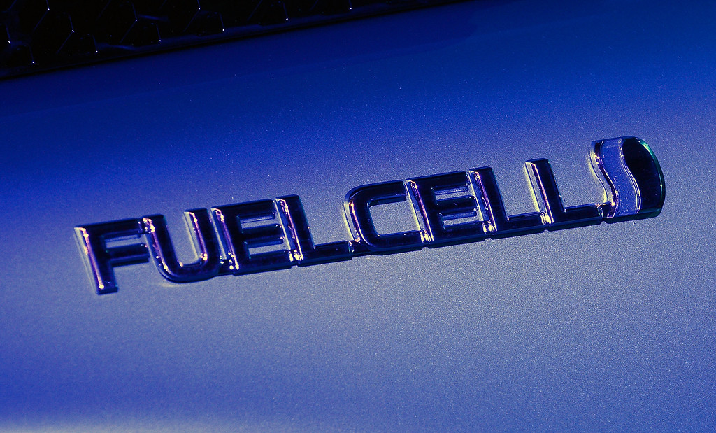 . The logo on a Toyota fuel cell concept vehicle is displayed during press event at the Mandalay Bay Convention Center for the 2014 International CES on January 6, 2014 in Las Vegas, Nevada. (David Becker/Getty Images)