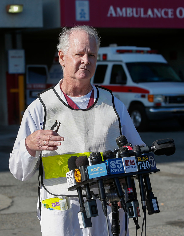 . Dr. Chris Barton, Chief of Emergency Services at San Francisco General Hospital, speaks to the media about the type of injuries passengers suffered on the Asiana Airlines Flight 214 that crashed at SFO on Saturday, July 6, 2013. (John Green/Bay Area News Group)