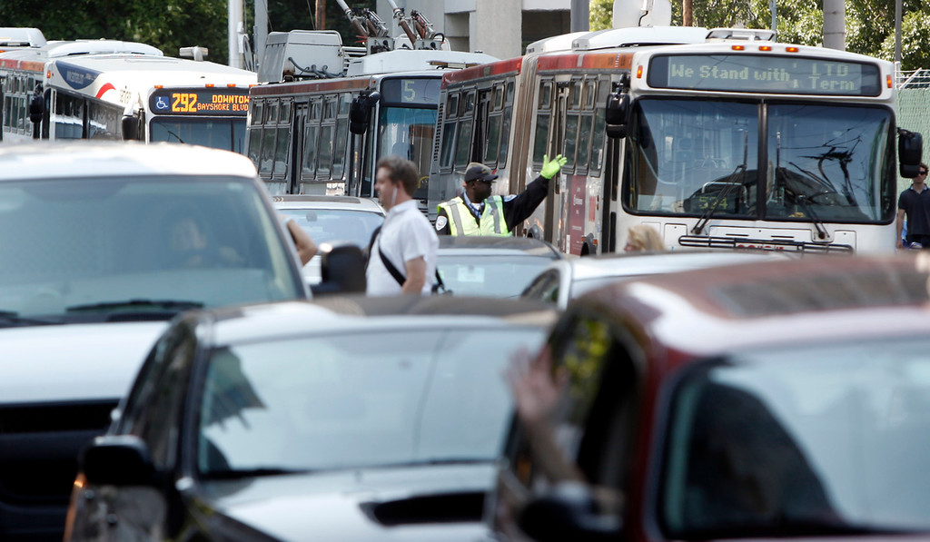 . Buses and autos clog Beale Street in downtown San Francisco, Calif., on the first day of the BART strike late Monday afternoon, July 1, 2013. (Karl Mondon/Bay Area News Group)