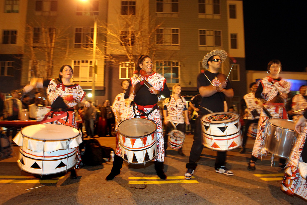 . Brazilian drumming band Batala, of San Francisco, perform during the First Friday/Art Murmur on Telegraph Avenue in Oakland, Calif., on Friday, March 1, 2013. Police presence was noticeable since it marked a month when 18-year-old Kiante Campbell was shot and killed after the event in the parking lot of a beauty supply business in the 2000 block of Telegraph Avenue.  (Ray Chavez/Staff)