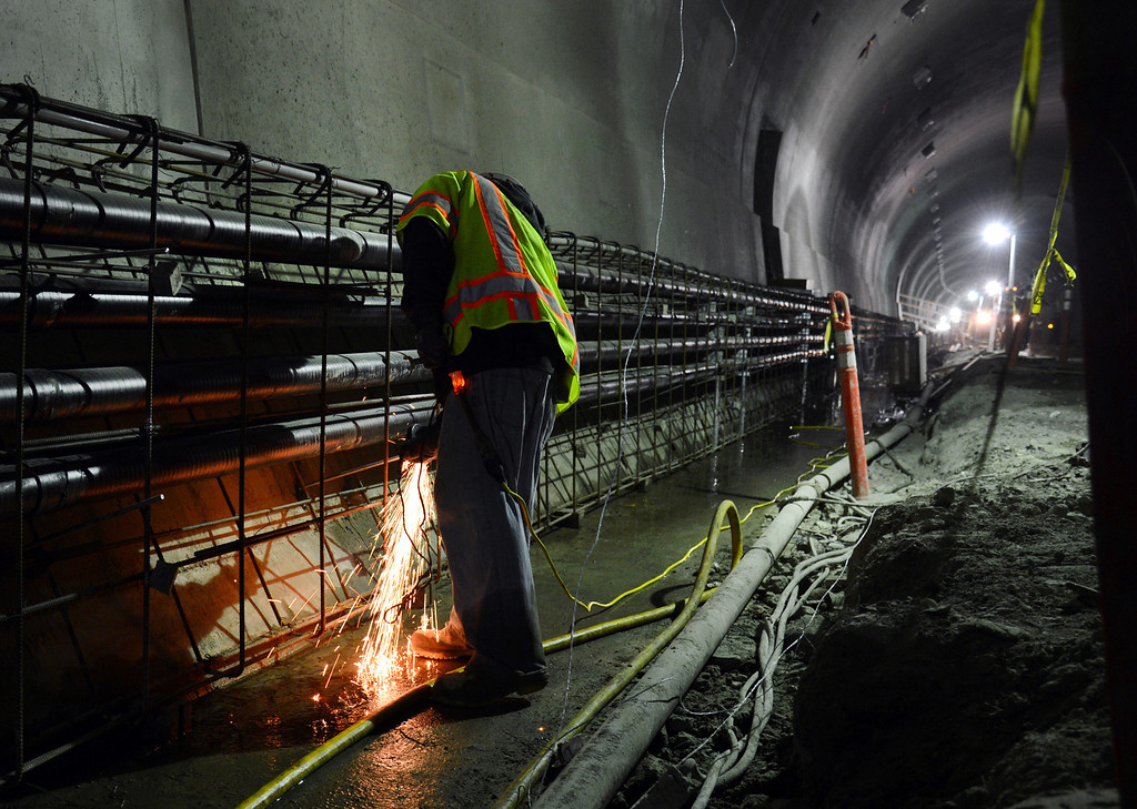 . An iron worker grinds away at rebar being used to build up a sidewalk in the Caldecott Tunnel fourth bore project Friday afternoon Jan. 18, 2013 near Orinda, Calif. The long-awaited project expects to open sometime in the latter part of 2013. (Karl Mondon/Staff)