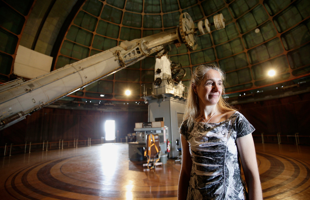 """. Astronomer Elinor Gates stands next to the 36\"""" Refractor telescope at Lick Observatory east of San Jose, Calif. on Wednesday, May 8, 2013. The observatory will be celebrating its 125th anniversary.  (Gary Reyes/ Bay Area News Group)"""